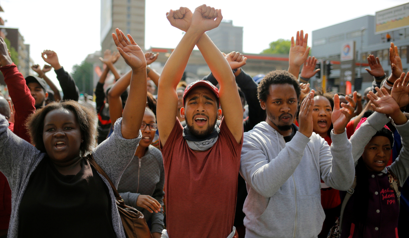 epa05594067 Students from Wits University hold their hands up pleading for police not to shoot them during a march to protest against the cost of higher education in Johannesburg, South Africa, 20 October 2016. The ministry of education announced an eight percent increase of university fees following calls by student demonstrators for a zero percent rise.  The violent protests have spread to many of the countries higher education campuses and are in a second month.  EPA/KIM LUDBROOK